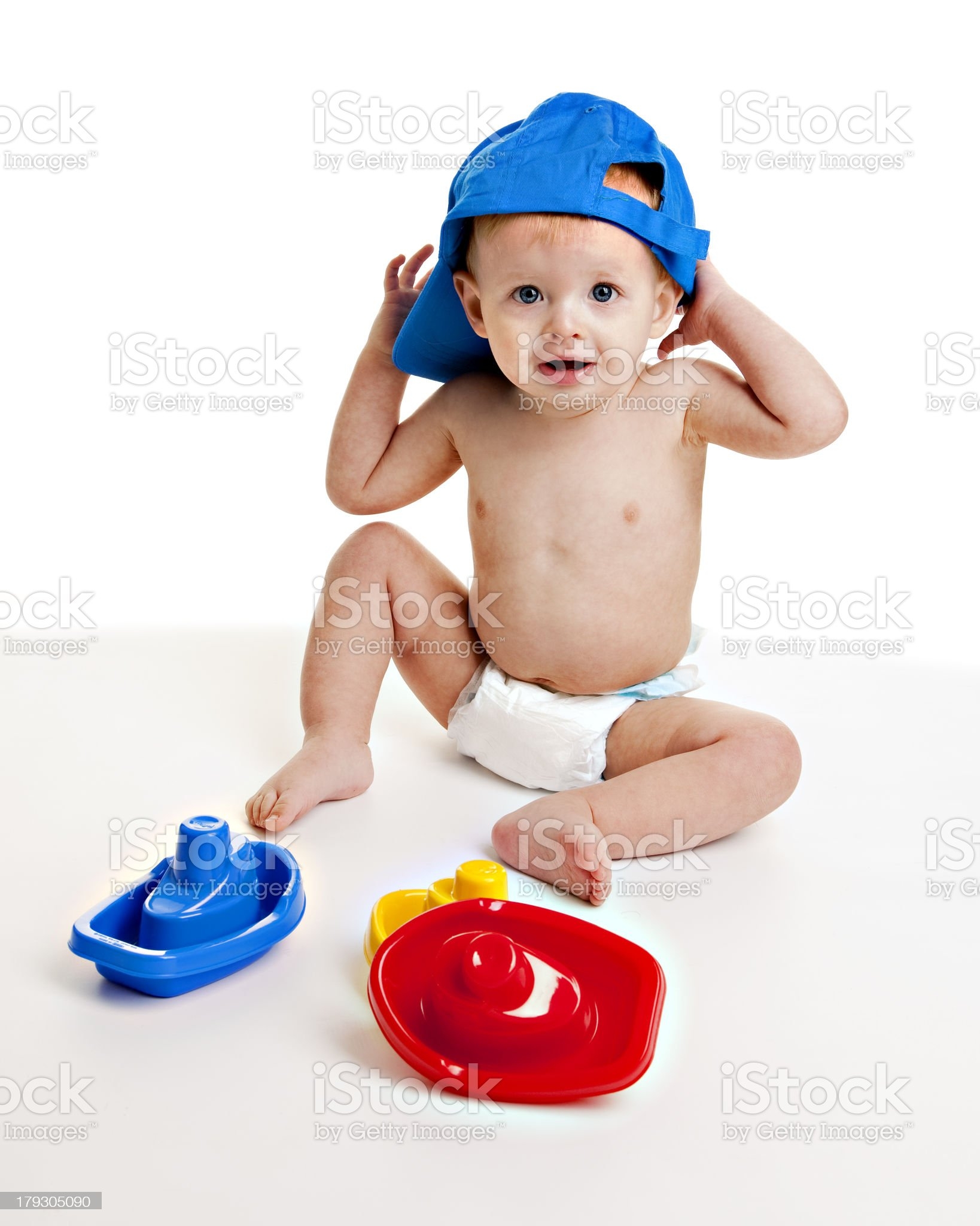 Happy Baby Boy Playing with Toy Boats royalty-free stock photo