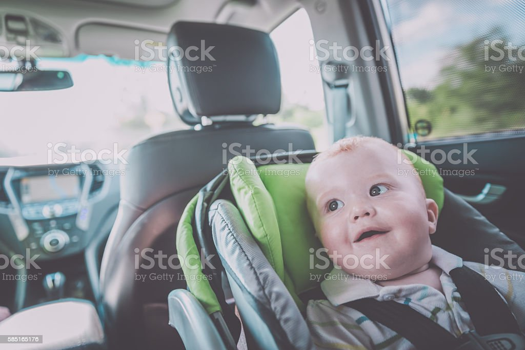 Happy Baby boy Secure in Baby Car Seat stock photo