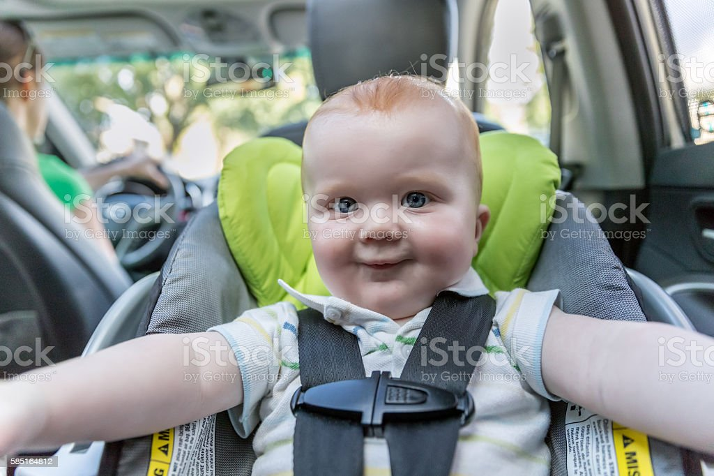 Happy Baby boy Secure in Baby Car Seat, Selfie stock photo