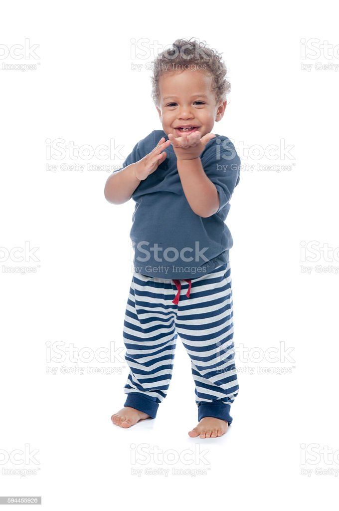 Happy Baby Clapping His Hands And Smiling stock photo