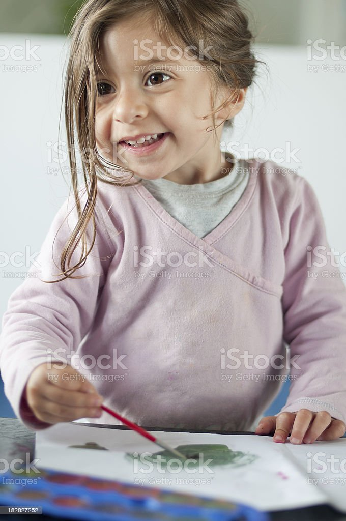 Happy Baby Girl in Pink Painting with Tempera royalty-free stock photo