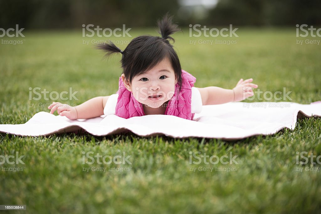Happy Baby Girl on Blanket at Park royalty-free stock photo