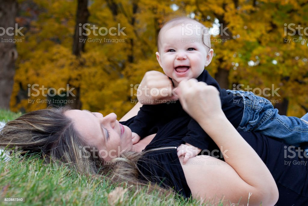 happy baby girl with mother stock photo