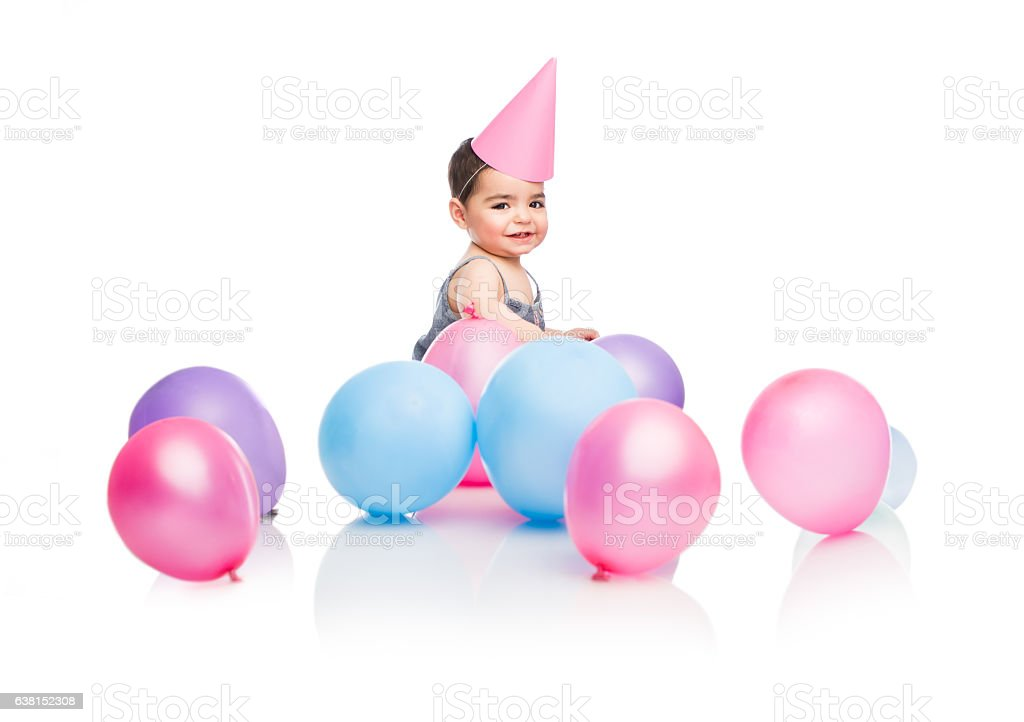 Happy baby girl with party balloons and hat stock photo