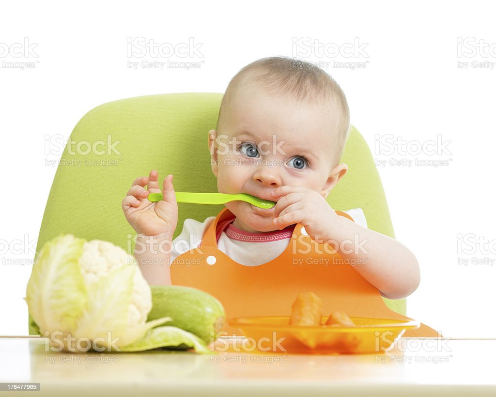 happy baby girl with vegetables stock photo