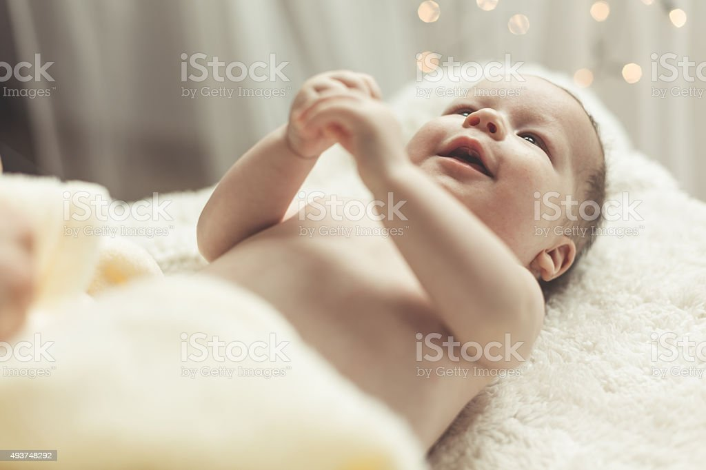 Happy baby holding hands together stock photo