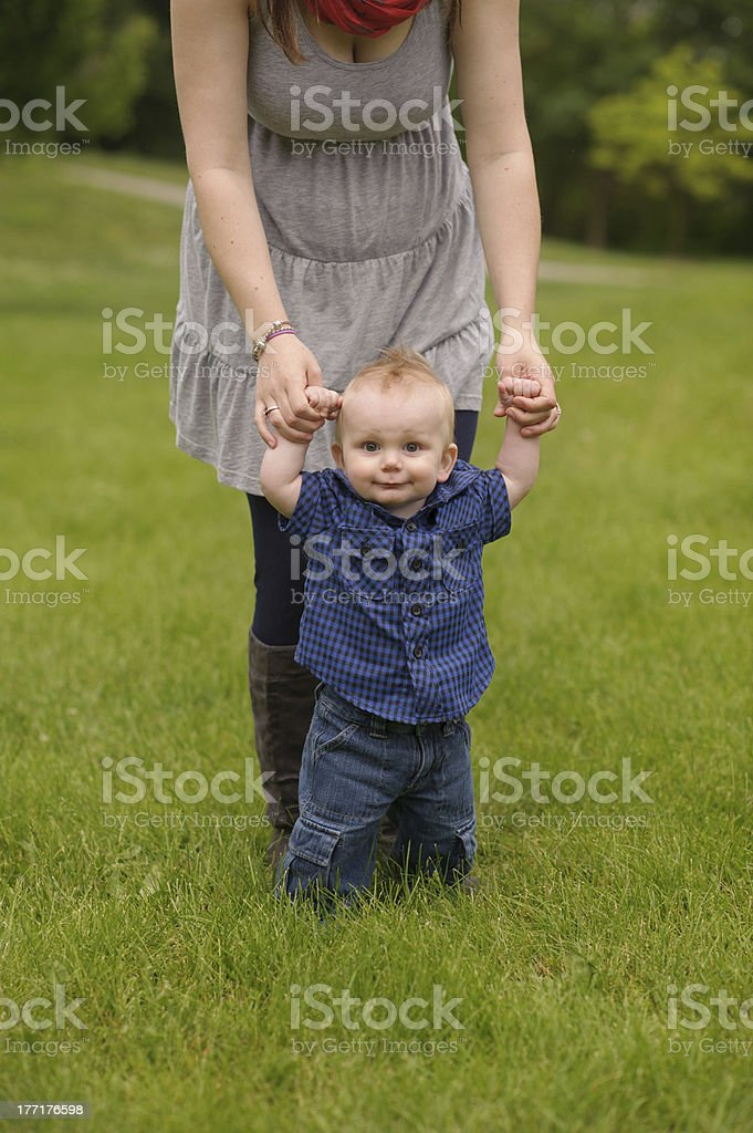 Happy Baby Holding Mother's Hands royalty-free stock photo