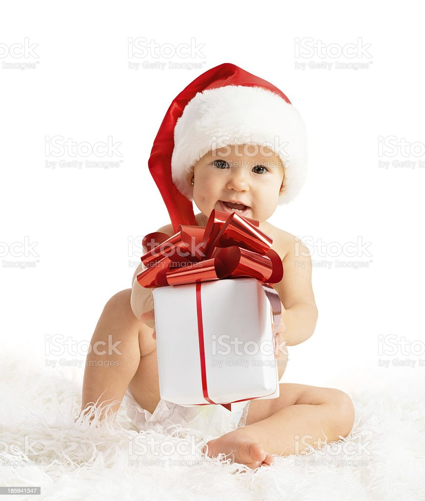 happy baby in a Christmas hat with gift isolated royalty-free stock photo