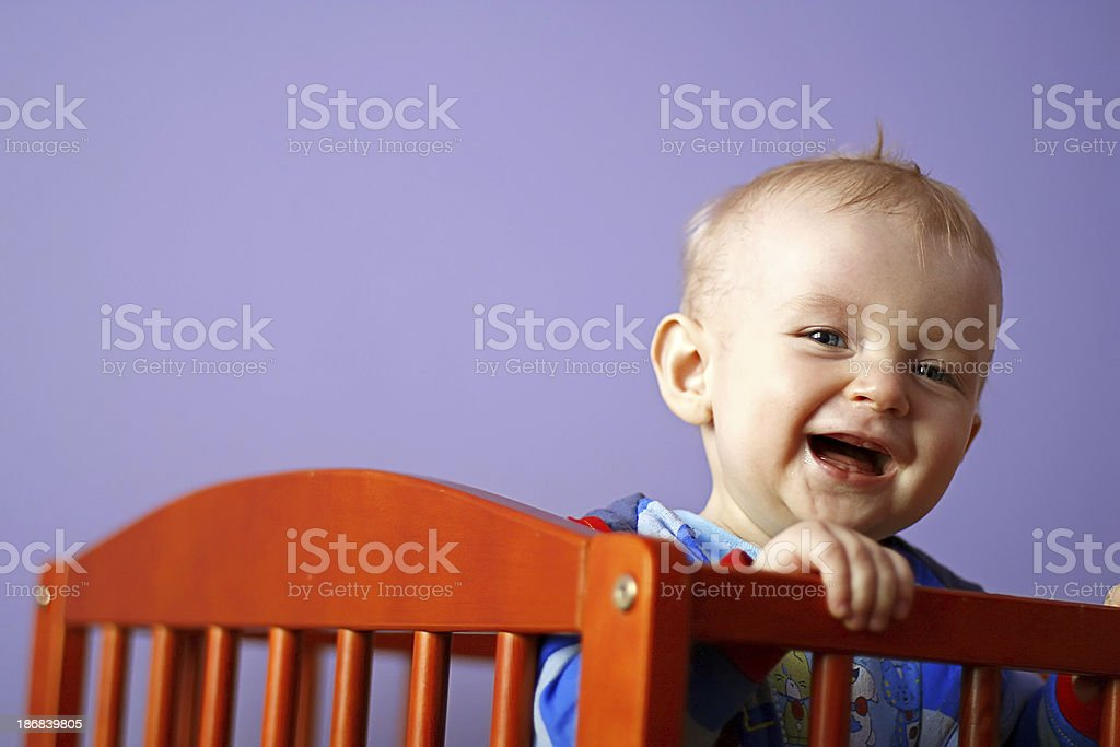 Happy baby in crib stock photo