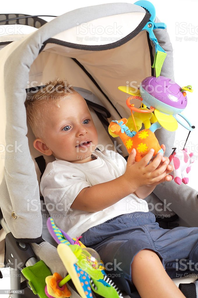 Happy baby in stroller royalty-free stock photo