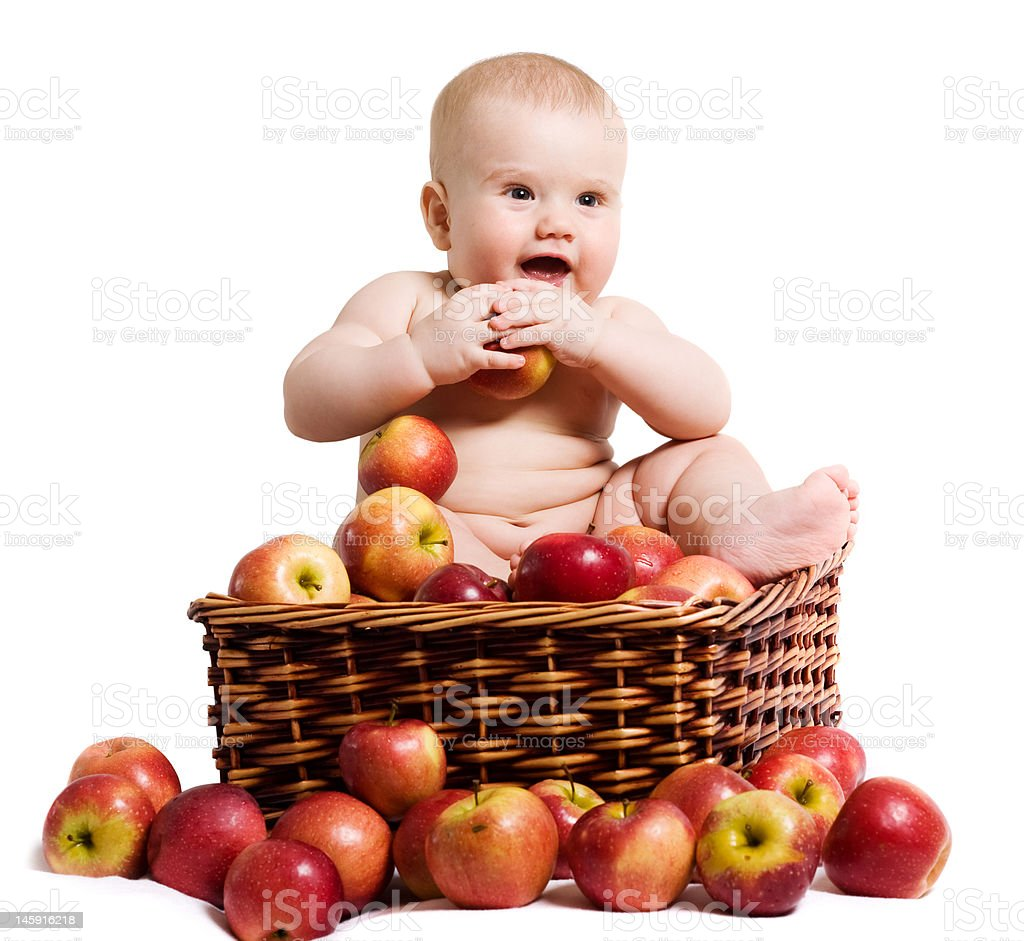 Happy baby in the basket with apples royalty-free stock photo