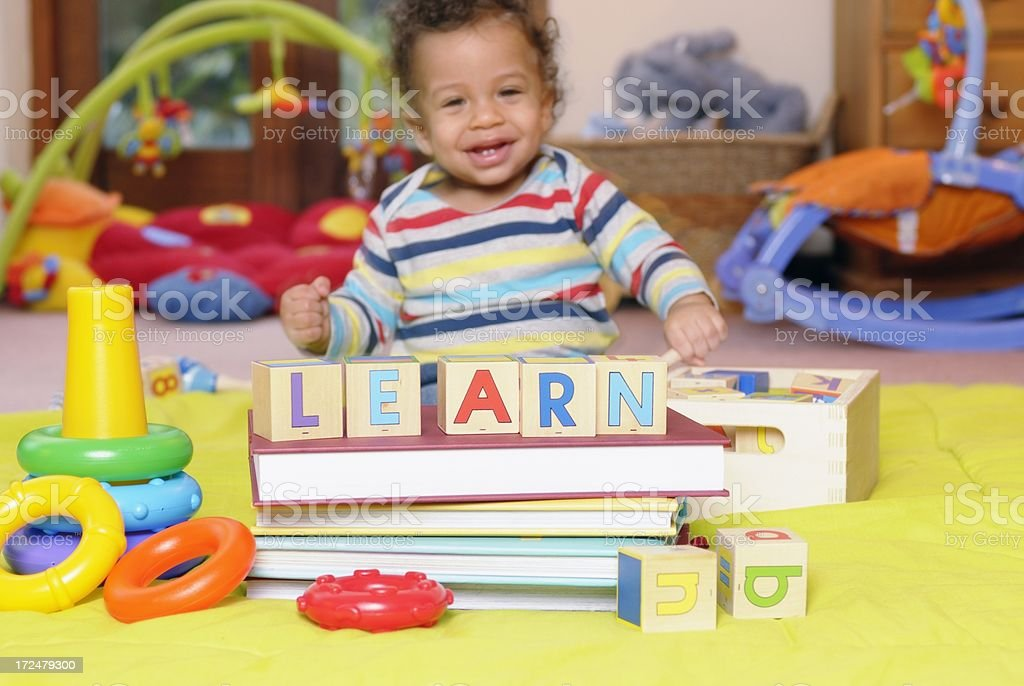 Happy Baby Learning Though Play - Using ABC (Building) Blocks royalty-free stock photo