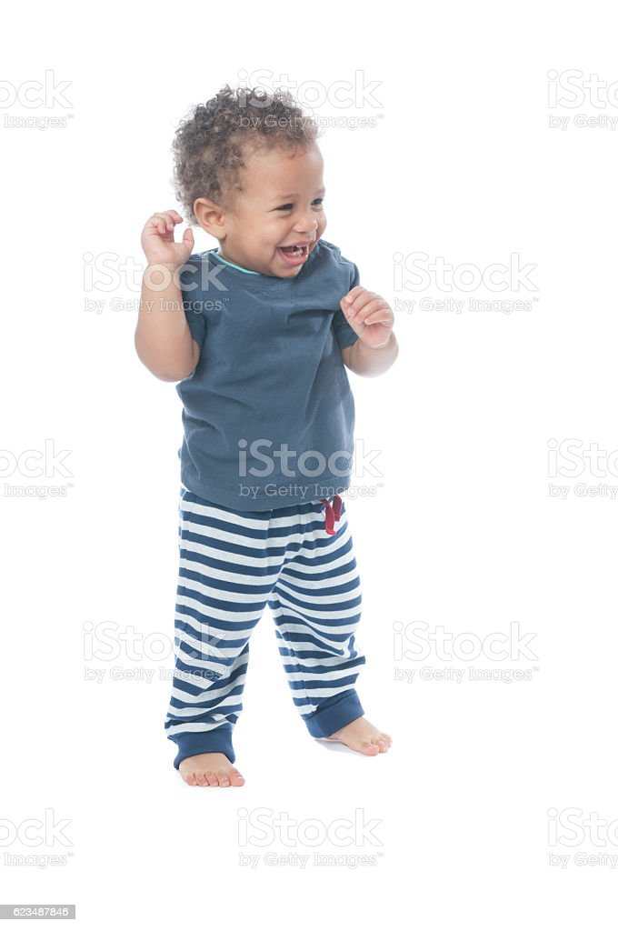 Happy Baby Raising His Arms, Looking Upwards And Smiling stock photo