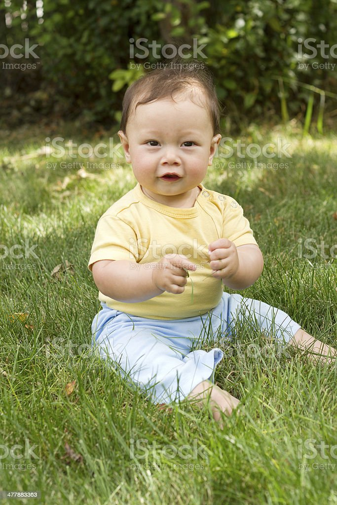 Happy Baby sitting on Grass royalty-free stock photo