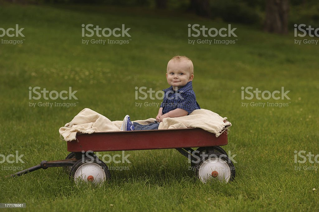Happy Baby Sitting on Vintage Wagon royalty-free stock photo