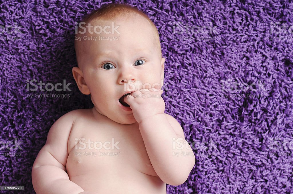Happy Baby Sucking on Fingers, With Copy Space royalty-free stock photo