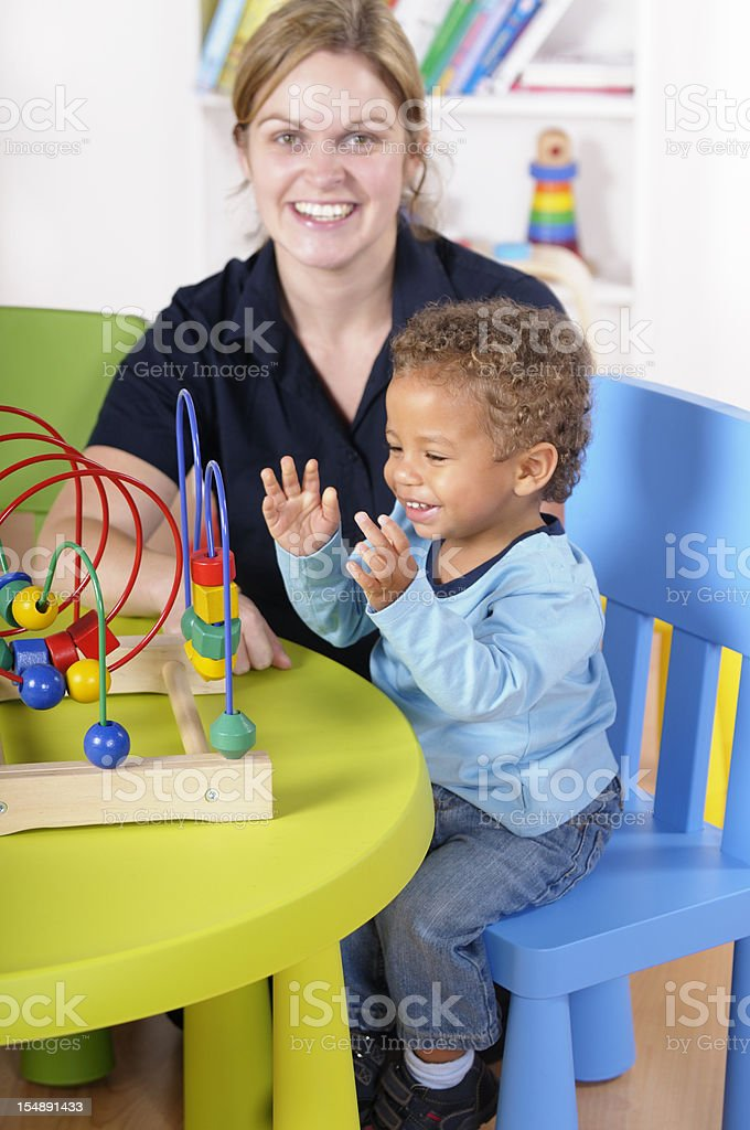 Happy Baby/ Toddler Clapping Hands In Excitement During Playtime stock photo