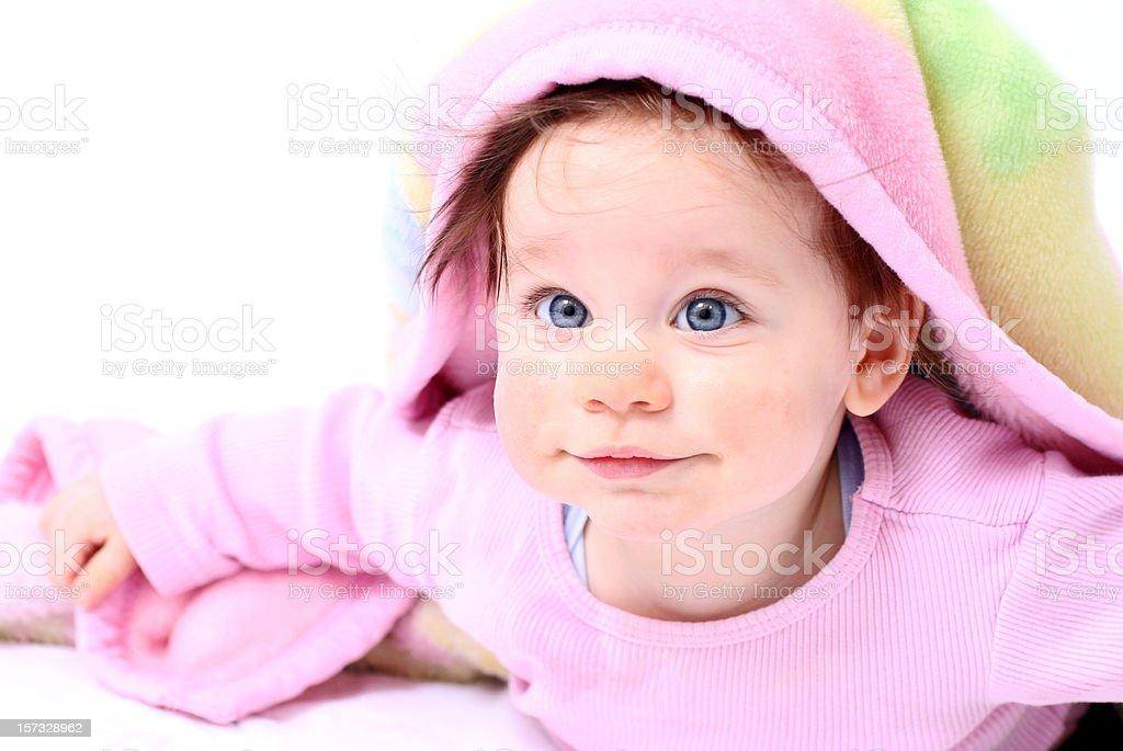 Happy baby under blanket stock photo