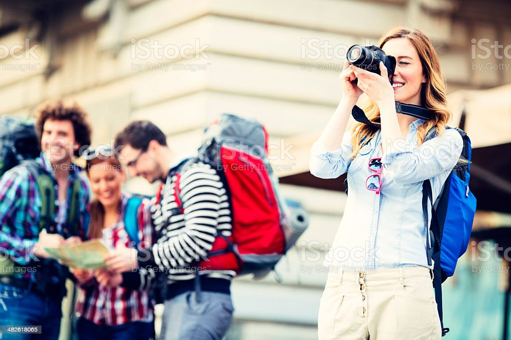 Happy Backpackers in the city. stock photo