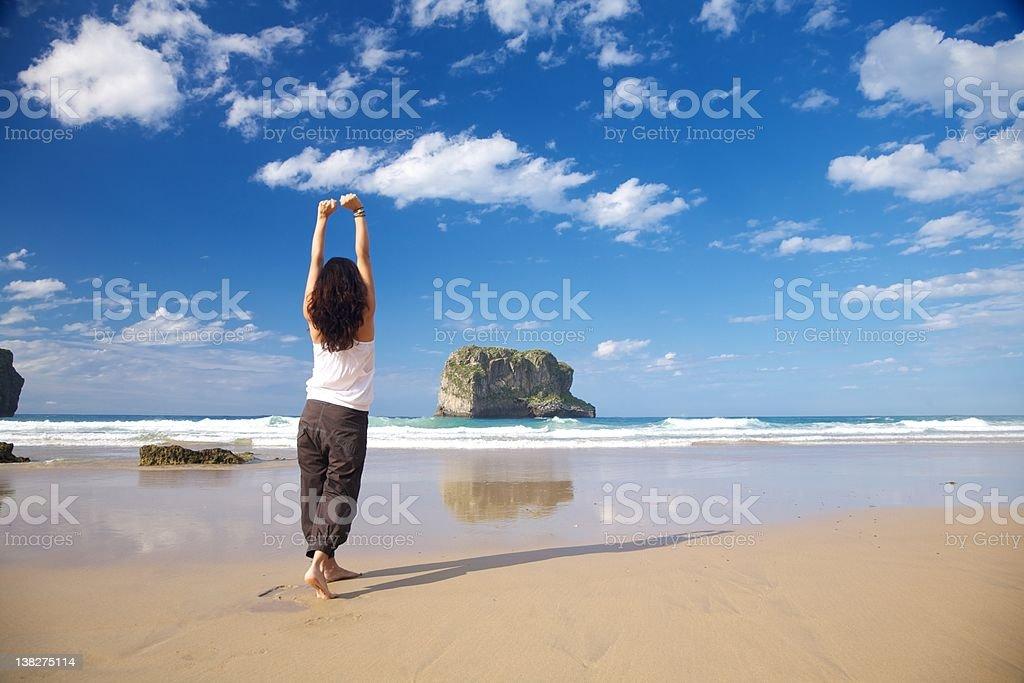 happy barefoot woman in Ballota beach royalty-free stock photo