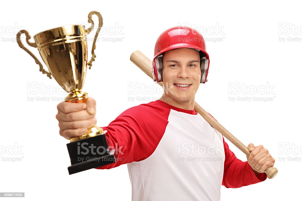 Happy baseball player holding a bat and a gold trophy stock photo