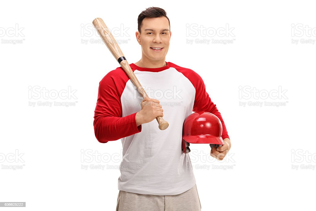 Happy baseball player holding a bat and a helmet stock photo