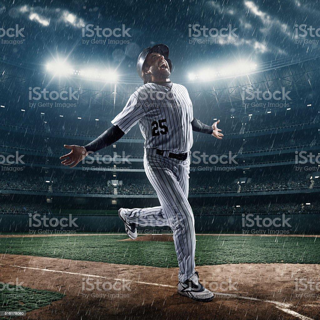 Happy baseball player in stadium stock photo