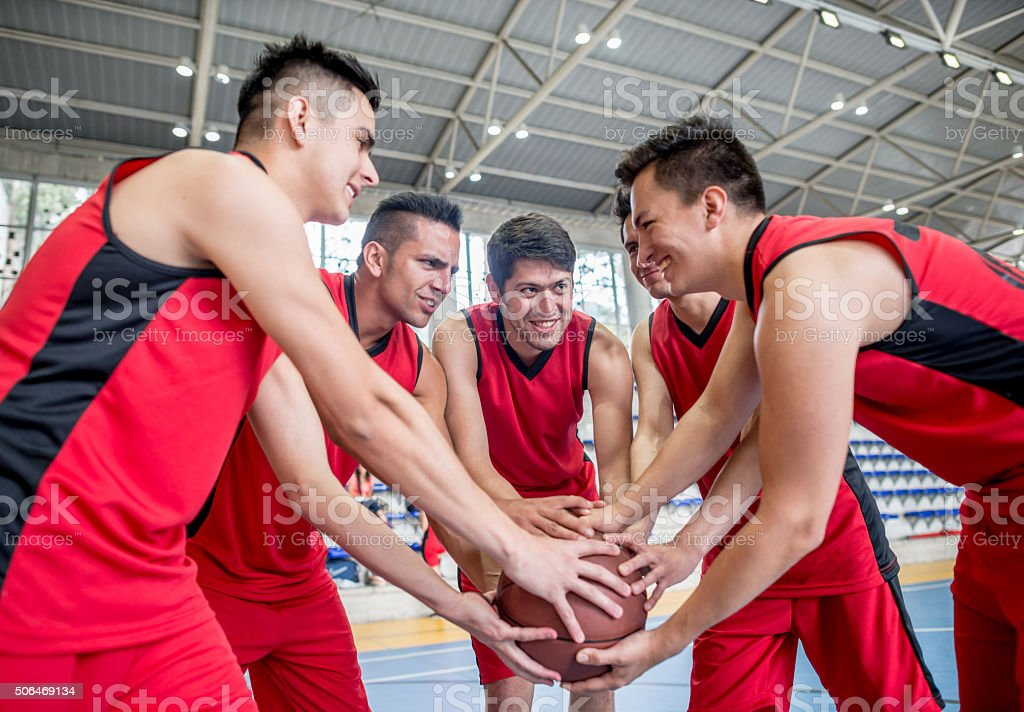 Happy basketball team stock photo