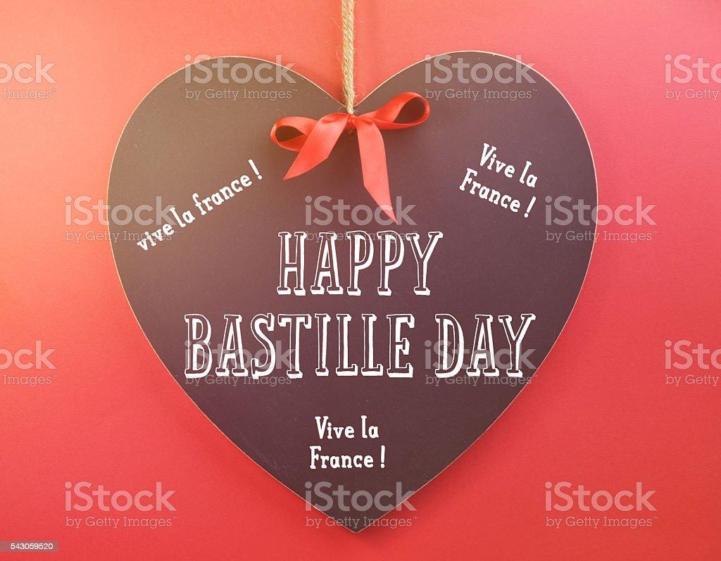 Happy Bastille Day greeting on heart shape blackboard stock photo