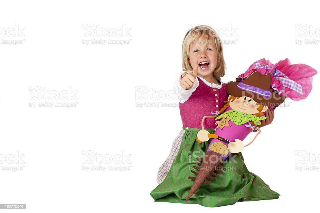 Happy Bavarian girl on first school day showing thumb up royalty-free stock photo