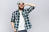 Happy bearded hipster posing on white background, in studio