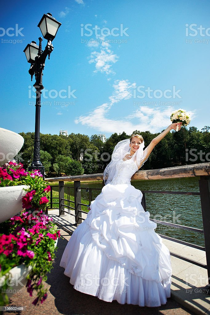 Happy beautiful bride in park royalty-free stock photo