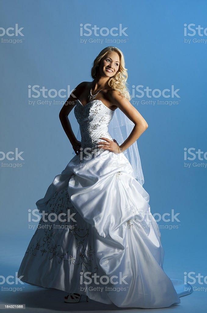 Happy beautiful bride on blue background royalty-free stock photo