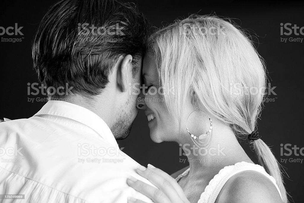 Happy beautiful couple cuddling royalty-free stock photo