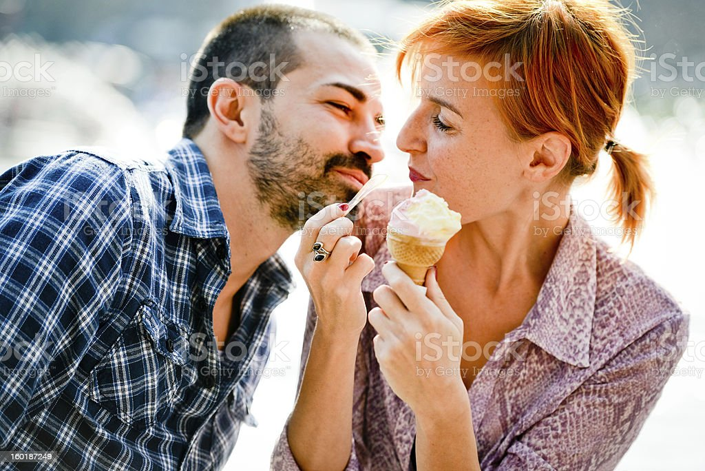 Happy Beautiful couple Eating Ice-Cream stock photo
