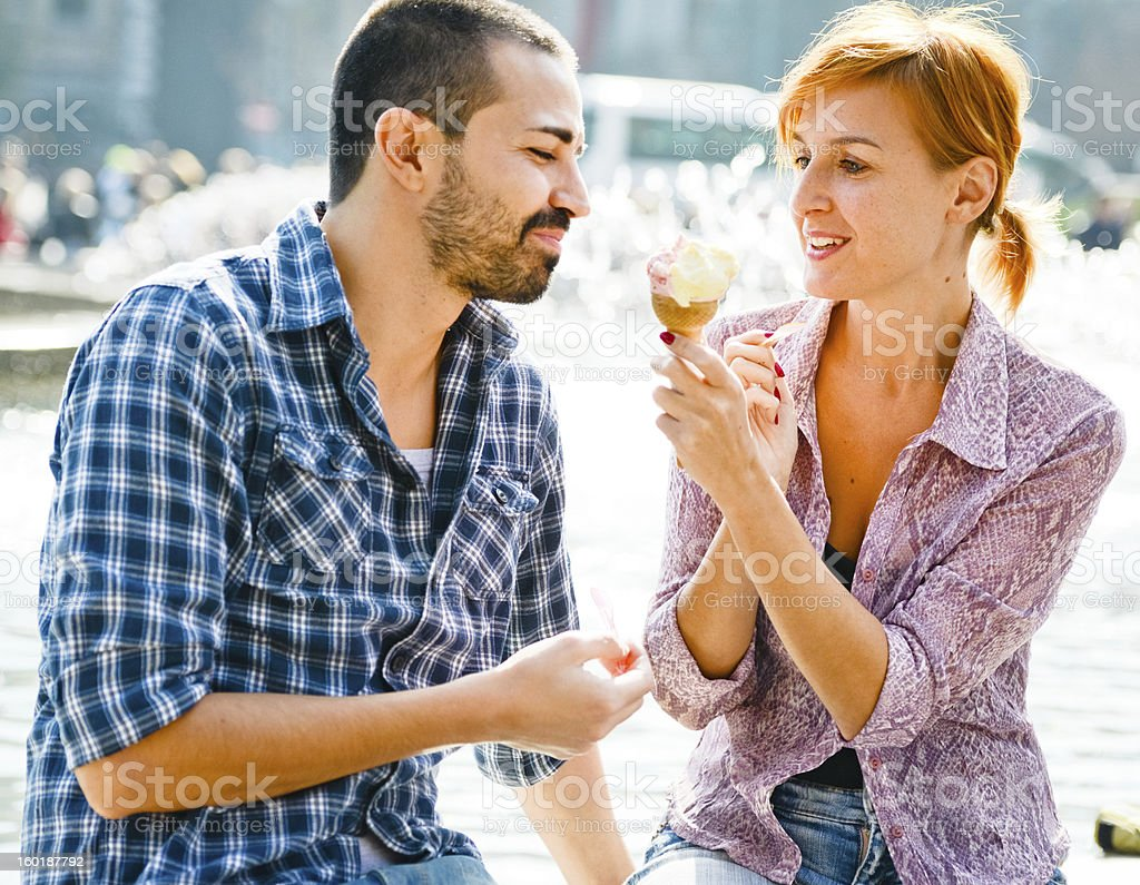 Happy Beautiful couple Eating Ice-Cream royalty-free stock photo