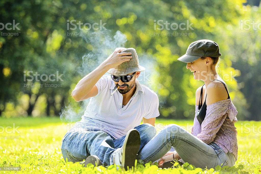 Happy Beautiful couple having fun in the park stock photo