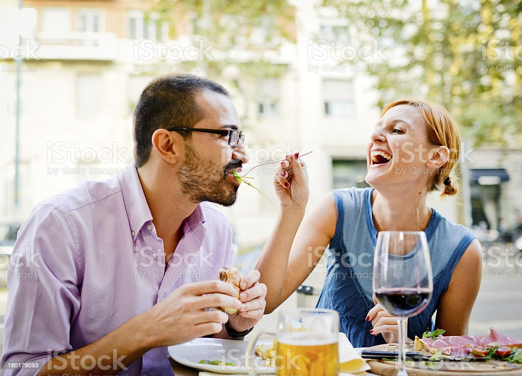 Happy Beautiful couple having lunch in outdoors cafe royalty-free stock photo