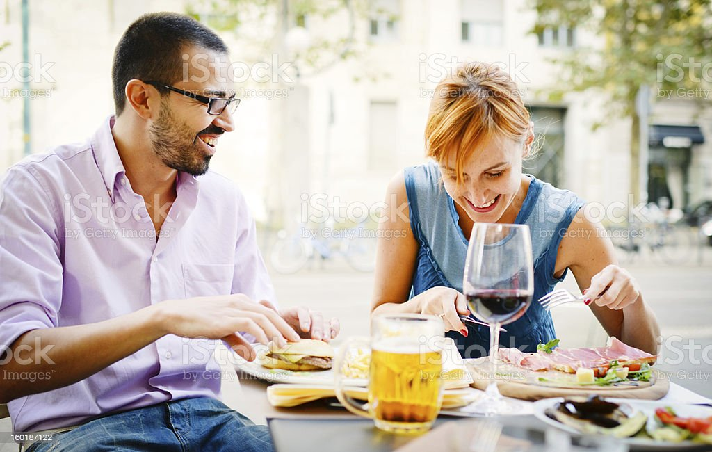 Happy Beautiful couple having lunch in outdoors cafe stock photo