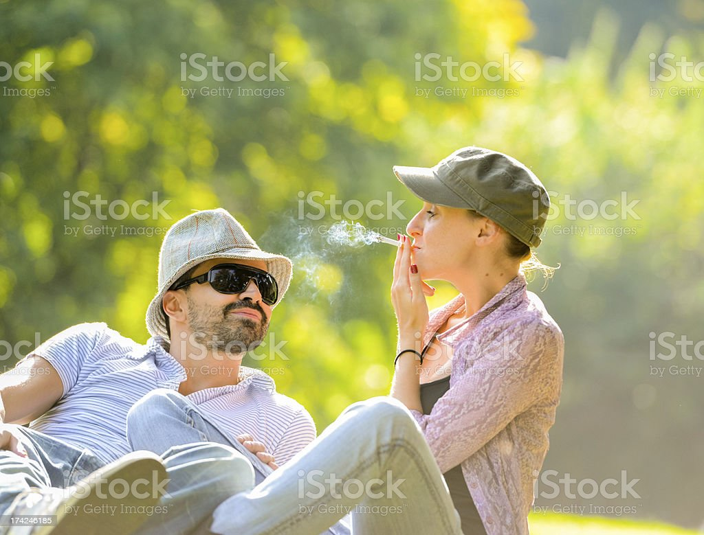 Happy Beautiful couple relaxing in the park stock photo