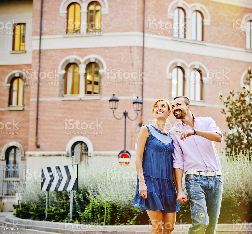 Happy Beautiful couple walking in the city stock photo