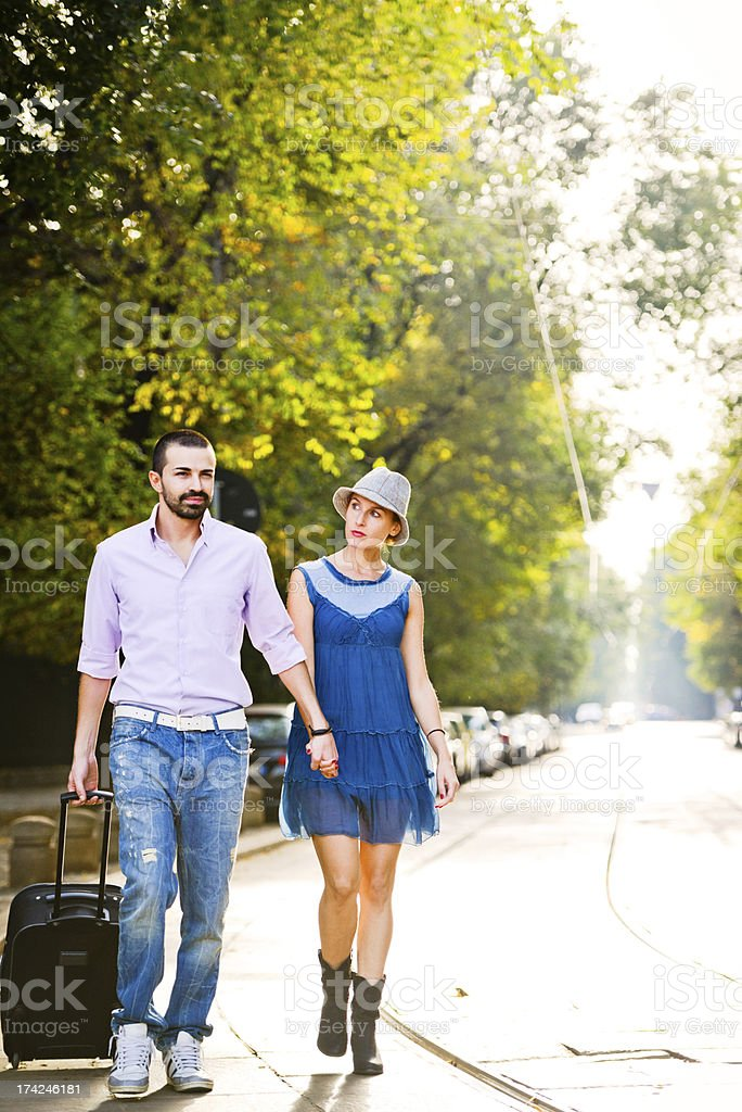 Happy Beautiful couple walking with suitcase stock photo
