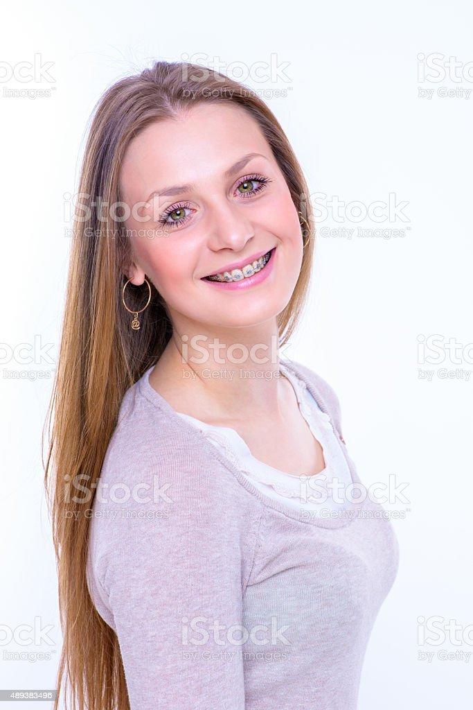 happy beautiful girl with braces stock photo