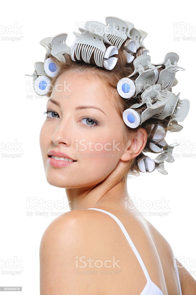 happy beautiful girl with curlers on her head stock photo