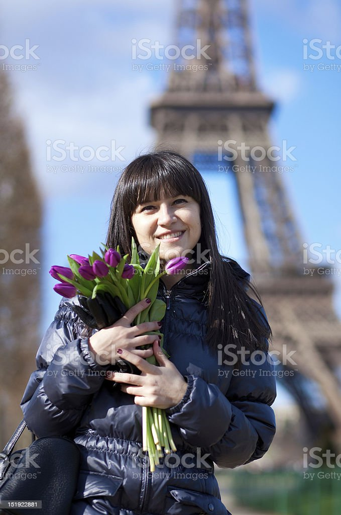 Happy beautiful girl with tulips enjoying spring day in Paris royalty-free stock photo