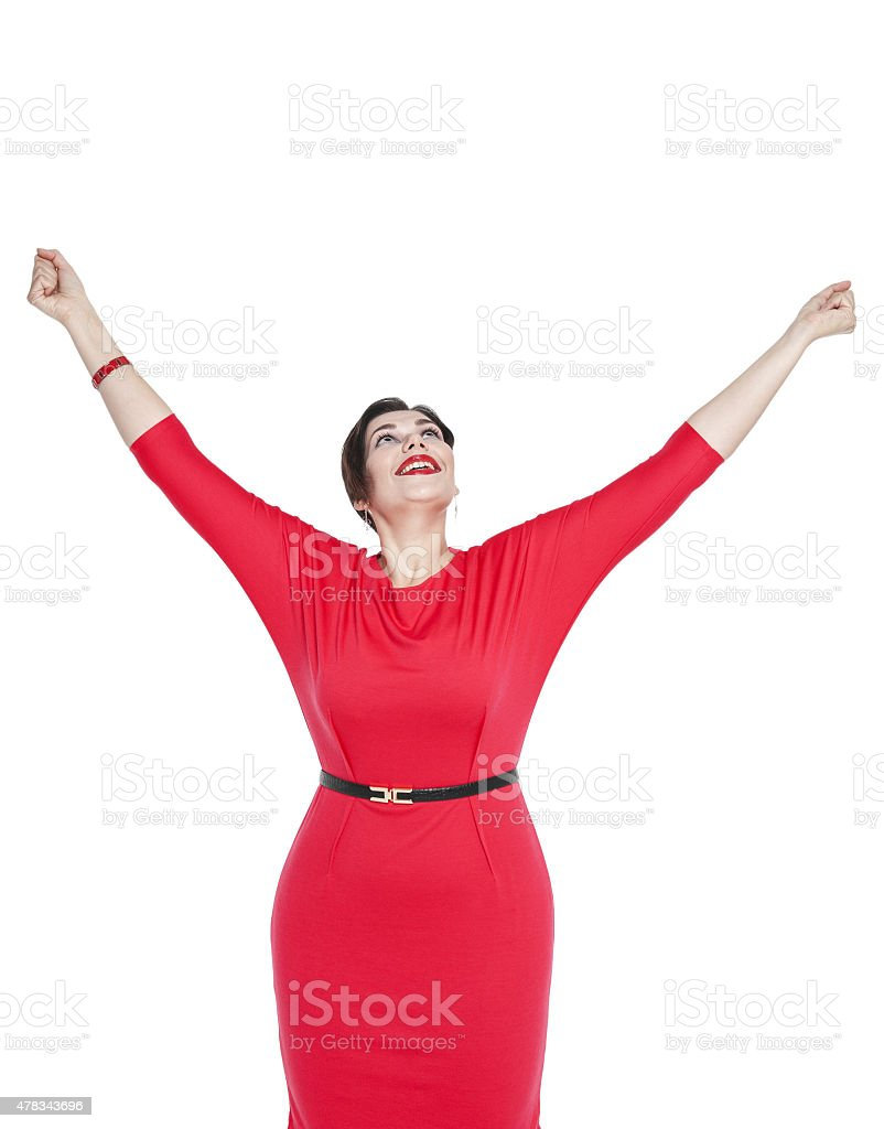 Happy beautiful plus size woman with hands up stock photo