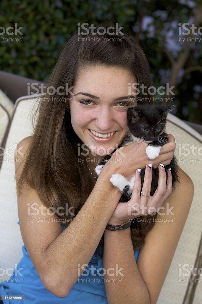 Happy Beautiful Teenage Girl Holding a Kitten Outdoors royalty-free stock photo