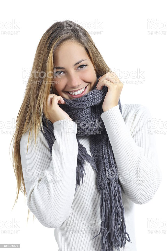 Happy beautiful woman keeping warm in a sweater royalty-free stock photo