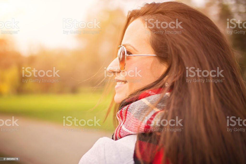 Happy beautiful woman outdoors stock photo