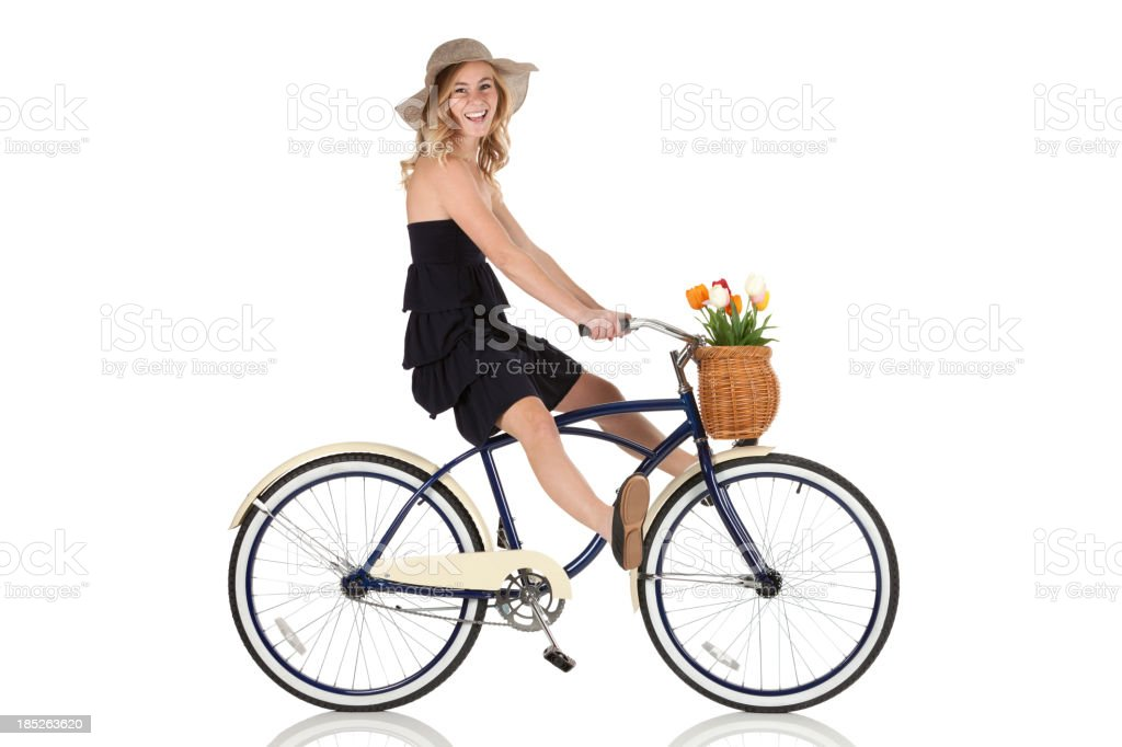 Happy beautiful woman riding a bicycle royalty-free stock photo